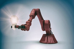 Composite image of illustrative image of red robotic arm holding light bulb 3d. Illustrative image of red robotic arm holding light bulb against purple vignette Stock Photo