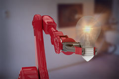 Composite image of illustrative image of robotic arm holding light bulb 3d Stock Photography