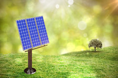 Composite image of image of 3d blue solar panel. Image of 3D blue solar panel against field against glowing lights Stock Photos