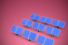 Composite image of image of 3d blue solar panel arranged in rows. Image of 3D blue solar panel arranged in rows against red and white background Stock Photography