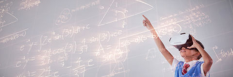 Composite image of image of geometric equations solved on blackboard. Image of geometric equations solved on blackboard against schoolboy using virtual reality Royalty Free Stock Photos