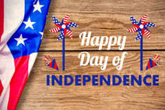 Composite image of  image of happy independence day text with decoration. Vector image of Happy Independence day text with decoration  against brown wood Stock Images