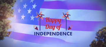 Composite image of  image of happy independence day text with decoration. Vector image of Happy Independence day text with decoration  against tree leaves Stock Images