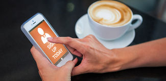 Composite image of image of sign up now text with human icon. Vector image of Sign Up Now text with human icon against woman having coffee and using her phone stock photos