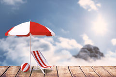 Composite image of image of sun lounger and sunshade. Image of sun lounger and sunshade against mountain peak through the clouds Stock Photos
