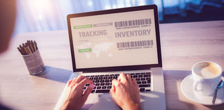 Composite image of image tracking inventory. Image tracking inventory against woman typing on laptop at table Stock Photography