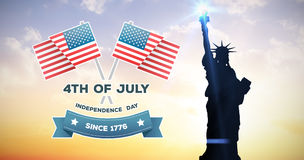 Composite image of independence day graphic. Independence day graphic against sunset with clouds Stock Photo