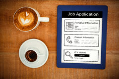 Composite image of informations for job application. Informations for job application against above view of coffee and a blue tablet Royalty Free Stock Photography