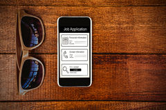 Composite image of informations for job application. Informations for job application against view of glasses and a smartphone Stock Image
