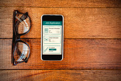 Composite image of informations for job application. Informations for job application against view of glasses and a smartphone Royalty Free Stock Photography