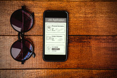 Composite image of informations for job application. Informations for job application against view of glasses and a smartphone Royalty Free Stock Photo