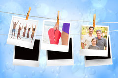 Composite image of instant photos hanging on a line Stock Photo