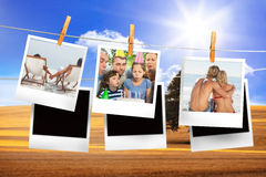 Composite image of instant photos hanging on a line Royalty Free Stock Images