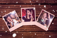 Composite image of instant photos on wooden floor Stock Photo