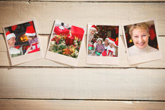 Composite image of instant photos on wooden floor. Instant photos on wooden floor against portrait of a smiling active seniors at christmas Stock Photos