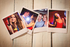 Composite image of instant photos on wooden floor Royalty Free Stock Photo