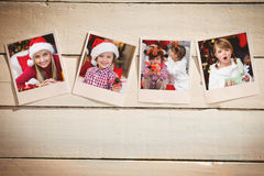 Composite image of instant photos on wooden floor Royalty Free Stock Image