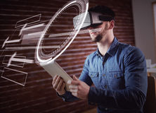 Composite image of interface. Interface against man wearing virtual glass while holding digital tablet Stock Image