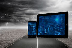 Composite image of interface on tablet and smartphone screens Royalty Free Stock Images