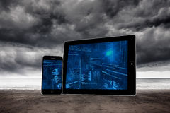 Composite image of interface on tablet and smartphone screens Stock Image