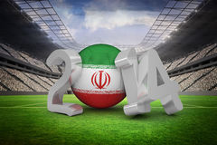 Composite image of iran world cup 2014. Iran world cup 2014 against vast football stadium with fans in white Royalty Free Stock Photos