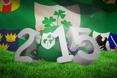 Composite image of ireland rugby 2015 message. Ireland rugby 2015 message against close-up of irfu flag with the centenary logo Royalty Free Illustration