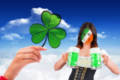 Composite image of irish girl with beer Royalty Free Stock Image