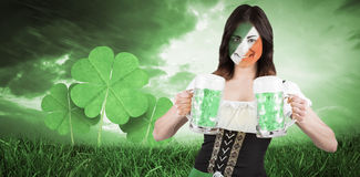 Composite image of irish girl with beer Stock Photos