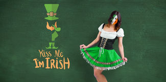 Composite image of irish girl smiling. Irish girl smiling against green chalkboard Stock Images