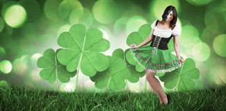 Composite image of irish girl smiling. Irish girl smiling against green glowing background Stock Images