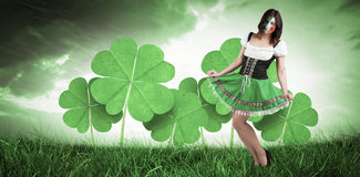 Composite image of irish girl smiling. Irish girl smiling against orange and blue sky with clouds Stock Images