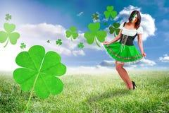 Composite image of irish girl smiling. Irish girl smiling against sunny landscape Stock Photos