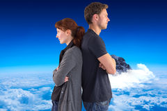 Composite image of irritated couple ignoring each other Stock Photography