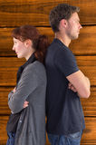Composite image of irritated couple ignoring each other Stock Image