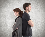 Composite image of irritated couple ignoring each other Royalty Free Stock Images