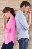 Composite image of irritated couple ignoring each other Royalty Free Stock Image