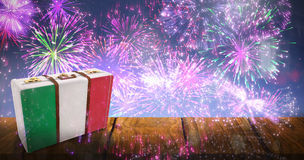 Composite image of italy flag suitcase. Italy flag suitcase against fireworks exploding over football stadium Stock Photos