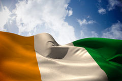 Composite image of ivory coast flag waving Royalty Free Stock Photography