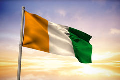 Composite image of ivory coast national flag Stock Photo