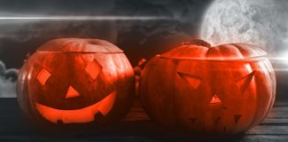 Composite image of jack o lanterns on wooden table Royalty Free Stock Photos