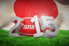 Composite image of japan rugby 2015 message. Japan rugby 2015 message  against flag of japan Stock Photo