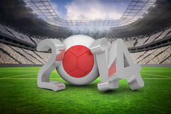 Composite image of japan world cup 2014. Japan world cup 2014 against vast football stadium with fans in white Royalty Free Stock Image