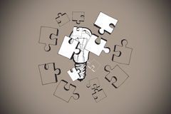 Composite image of jigsaw and light bulb doodle Royalty Free Stock Images