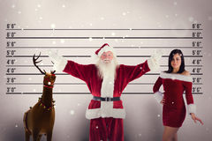 Composite image of jolly santa opens his arms to camera Royalty Free Stock Photos