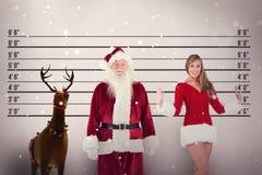 Composite image of jolly santa smiling at camera Stock Photo