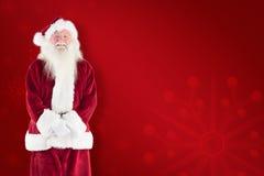 Composite image of jolly santa smiling at camera Royalty Free Stock Photography