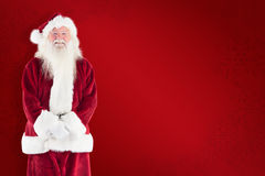 Composite image of jolly santa smiling at camera Royalty Free Stock Photos