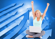 Composite image of joyful woman with a notebook Stock Photo