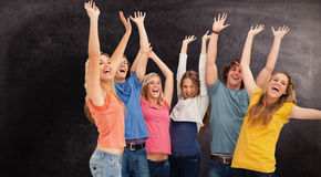Composite image of a jumping happy group cheering Stock Images