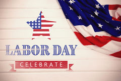 Composite image of labor day celebrate text and star shape american flag. Labor day celebrate text and star shape American flag against close-up of an american Stock Photo